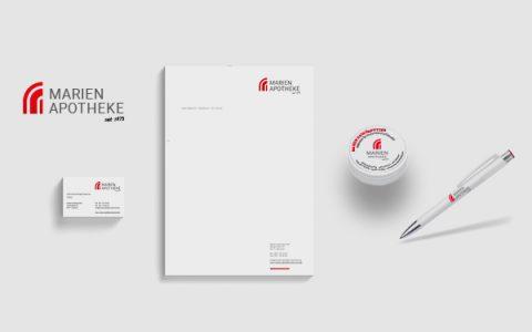 Corporate Design für die Marien-Apotheke. Logo, Briefbogen, Visitenkarten, Kugelschreiber und Dose.